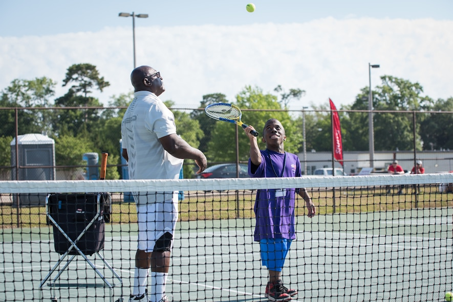Henry Harris, Special Olympics Mississippi tennis director, tosses a ball to Shaquille Williams, Area 7 athlete, during the Special Olympics Mississippi 2018 Summer Games at the tennis courts at Keesler Air Force Base, Mississippi, May 12, 2018. Founded in 1968, Special Olympics hosts sporting events around the world for people of all ages with special needs to include more than 700 athletes from Mississippi. (U.S. Air Force photo by Andre' Askew)
