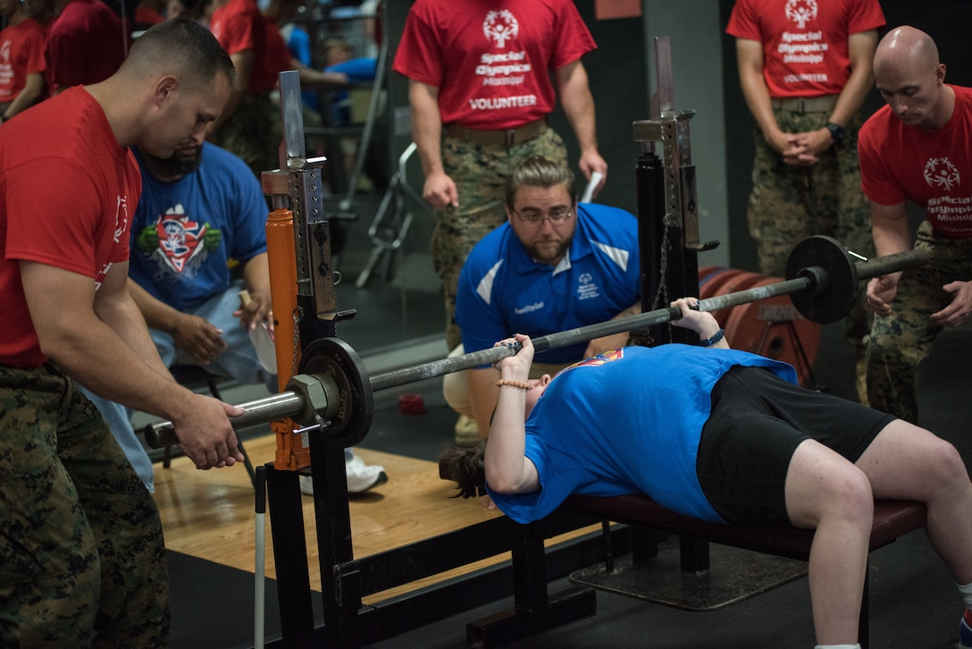 Lauren Smith, Area16 athlete,  competes in power lifting competition during the Special Olympics Mississippi 2018 Summer Games at the Triangle Fitness Center at Keesler Air Force Base, Mississippi, May 12, 2018. Founded in 1968, Special Olympics hosts sporting events around the world for people of all ages with special needs to include more than 700 athletes from Mississippi. (U.S. Air Force photo by Andre' Askew)