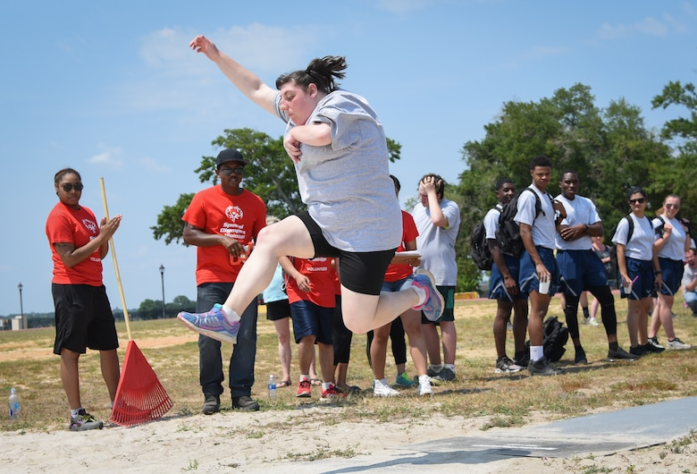 Cassidy Gamblin, Area 16 athlete, competes in the running long jump during the Special Olympics Mississippi 2018 Summer Games at the Triangle Track at Keesler Air Force Base, Mississippi, May 12, 2018. Founded in 1968, Special Olympics hosts sporting events around the world for people of all ages with special needs to include more than 700 athletes from Mississippi. (U.S. Air Force photo by Kemberly Groue)