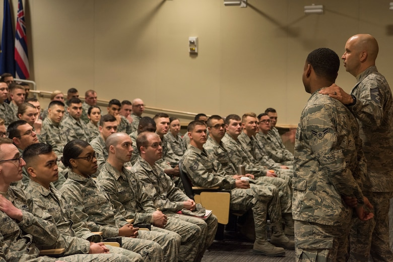 Chief Master Sgt. Charles Orf, 673d Air Base Wing command chief, speaks to Airman Leadership School graduates at Joint Base Elmendorf-Richardson, Alaska, May 10, 2018. The graduates took part in a new Pacific Air Forces-wide initiative for all ALS graduates to reinforce information obtained in Initial Supervisor Resiliency Training. At the forefront of this initiative is a bus tour the day after graduation, which offers an opportunity to see and interact with the programs and resources discussed during the course.
