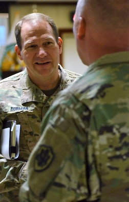 U.S. Army Major General Edward Dorman, Director of Logistics and Engineering for U.S. Central Command, speaks with a fellow logistician at the Joint Logistics Coordination Board at Al Udeid Air Base, Qatar on 9 May, 2018. Dorman urged participants to stay focused on sustaining the fight and setting the theater as a means to support military operations. (U.S. Air Force photo by Senior Airman Patrick Wyatt