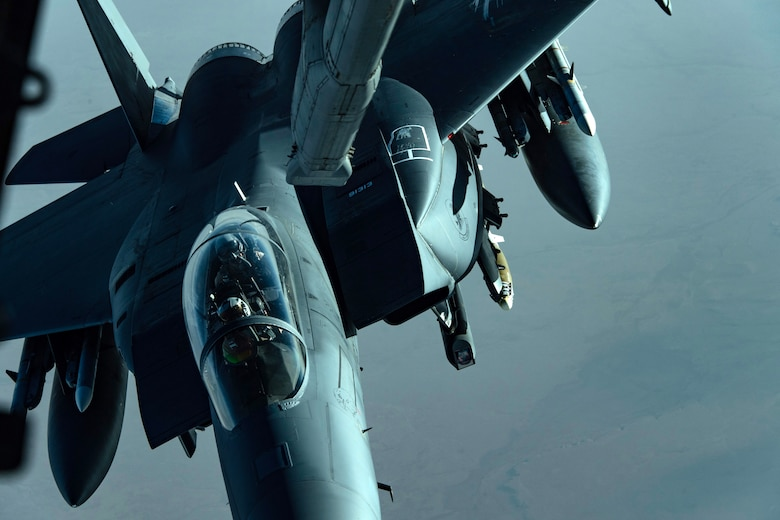 A U.S. Air Force F-15E Strike Eagle assigned to the 48th Fighter Wing, Royal Air Force Lakenheath, prepares to receive fuel from a U.S. Air Force KC-10 Extender from the 380th Air Expeditionary Wing over Southwest Asia, April 21, 2018. (U.S. Air National Guard photo by Tech. Sgt. Nieko Carzis)