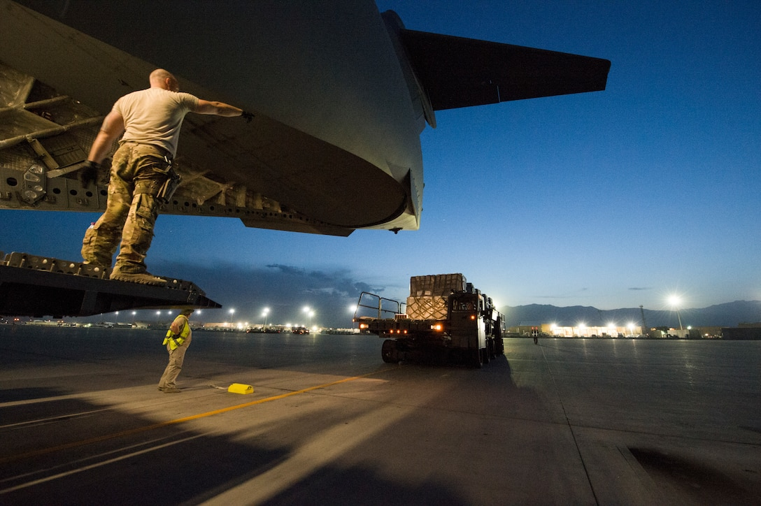 U.S. Air Force Senior Airman Jeremy Kosick, 816th Expeditionary Airlift Squadron instructor loadmaster, guides a K-loader back after off loading cargo onto a C-17 Globemaster III before a airdrop mission at Bagram Airfield, May 10, 2018. The C-17 transported troops and cargo to forward operating locations throughout the U.S. Central Command area of responsibility in support of Operation Freedom Sentinel mission. The C-17 is not only proficient in transporting troops and supplies, but can also perform tactical airlift and airdrop missions and transport ambulatory patients during aeromedical evacuations. (U.S. Air Force photo by Staff Sgt. Keith James)