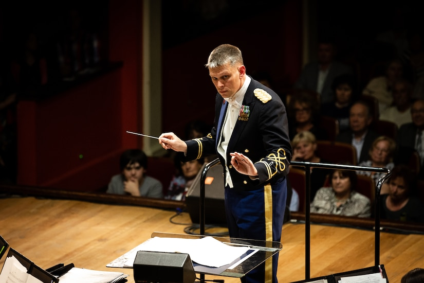 CW2 Chapman conducts the band