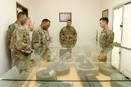 Soldiers with the 40th Brigade Engineer Battalion (BEB), 2d Brigade Combat Team, 1st Armored Division visit the Kuwait Land Forces (KLF) Institute Headquarters, Explosive Ordnance Disposal (EOD) Unit Museum during Kuwait Engineer Week. The week-long information exchange between the KLF and U.S. Army engineers enabled them to interact and share knowledge in their technical and tactical professional engineer methodologies, April 12, 2018.