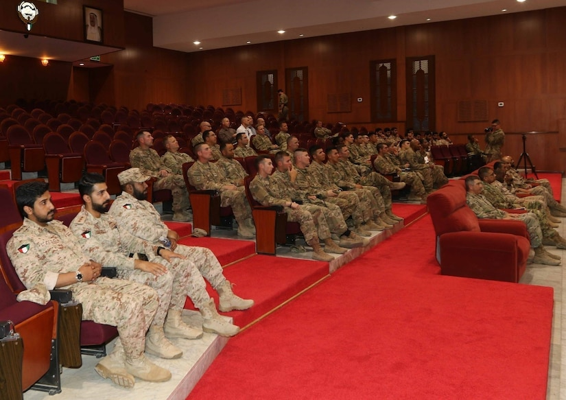 The 40th Brigade Engineer Battalion (BEB), 2d Brigade Combat Team, 1st Armored Division and the Kuwait Land Force (KLF) engineers attend a graduation ceremony at the KLF Institute Headquarters. The ceremony honored soldiers who participated in the week-long training to exchange technical and tactical professional engineer methodologies, April 12, 2018.