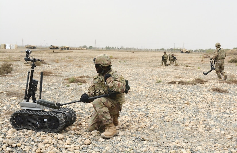 Soldiers of the 40th Brigade Engineer Battalion (BEB) demonstrate dismounted explosive hazard clearance operations with the Talon Robot, and VMR/2 Mine Hound to a group of more than 60 Kuwait Land Forces soldiers, U.S. Army engineers, and British liaison soldiers, during Engineer Week, April 9-13.