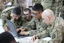 335th Signal Command (Theater) (Provisional) team participates in Best Cyber Ranger competition, Camp Arifjan, Kuwait, May 8.