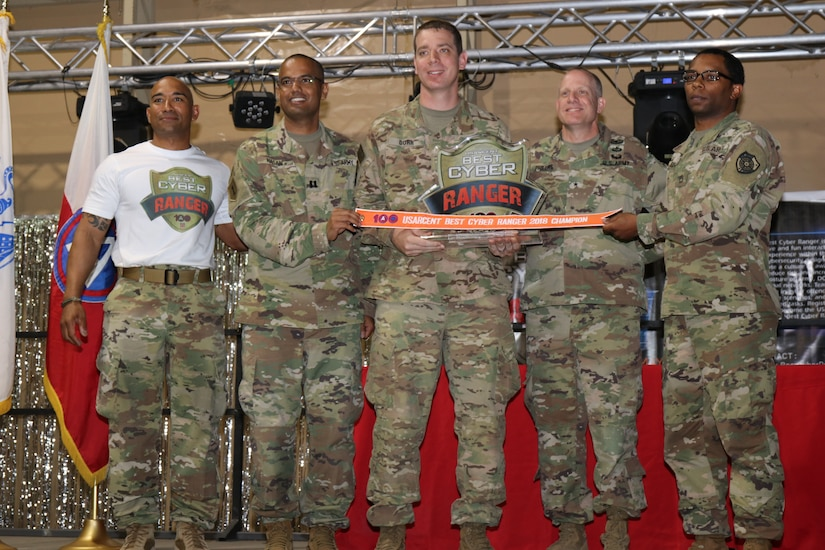 Cyber Protection Team 100, from Fort Gordon, Ga. accepts overall first place trophy for the Best Cyber Ranger Competition, Camp Arifjan, Kuwait, May 10.
