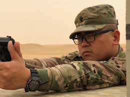 Spec. Brandon Xiong qualifies with an 9mm at the Udairi Training Range, Kuwait, May 8, 2018. Xiong is an information technician for ASG-Kuwait, stationed at Camp Buehring.