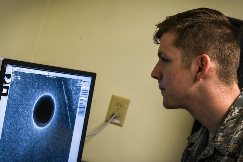 U.S. Air Force Airman 1st Class Tyler Chance, 20th Equipment Maintenance Squadron nondestructive inspection (NDI) journeyman, reviews an X-ray image on a Computed Radiography Flex 2 system at Shaw Air Force Base, S.C., April 25, 2018.