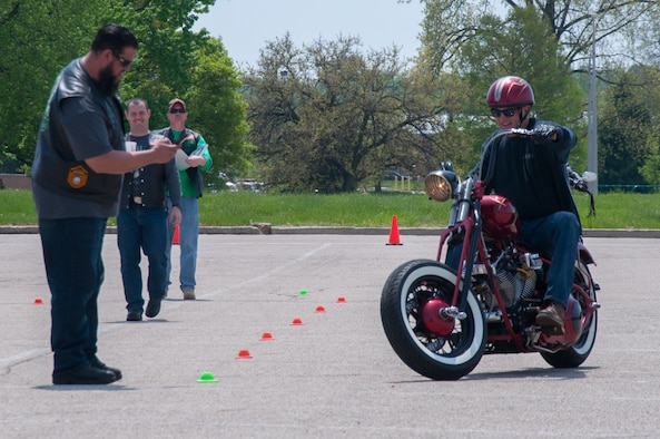 A rider competes in a slow ride contest as part of Wright-Patterson's Motorcycle Safety Day 2018.