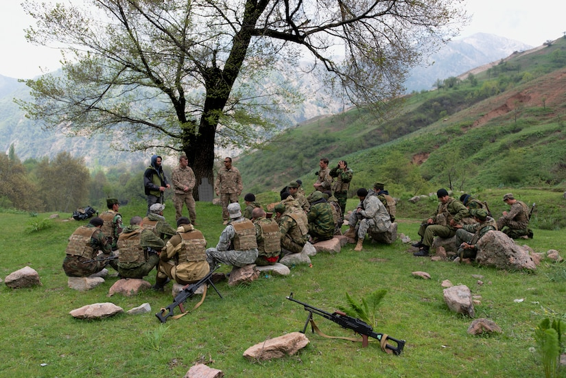 Tajik and U.S. soldiers conduct an after-action review at a mountain training camp outside of Dushanbe, Tajikistan, April 20, 2018, after a simulated patrol through the mountains, an exercise conducted during an exchange of tactics and best practices between the two countries. This information exchange was part of a larger military-to-military engagement taking place with the Tajikistan Peacekeeping Battalion of the Mobile Forces and the 648th Military Engagement Team, Georgia Army National Guard, involving border security tactics and techniques.
