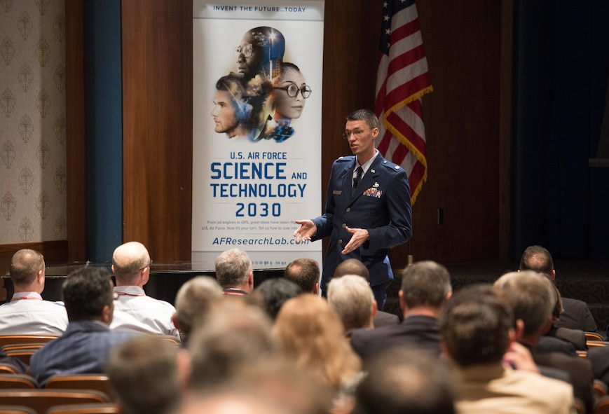 Maj. Brook Bentley, program manager with the Air Force Research Laboratory, introduces the technical themes of the U.S. Air Force Science and Technology 2030 Forum held May 10 at Indiana University. (Indiana University photo/Chris Meyer)