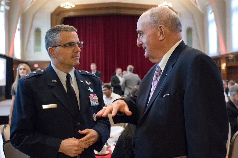 Maj. Gen. William Cooley, commander of the Air Force Research Laboratory, and Dr. Michael McRobbie, president, Indiana University, discuss partnership opportunities between higher education and the Air Force at the Air Force Science and Technology 2030 Forum held May 10 at Indiana University. (Indiana University photo/Chris Meyer)