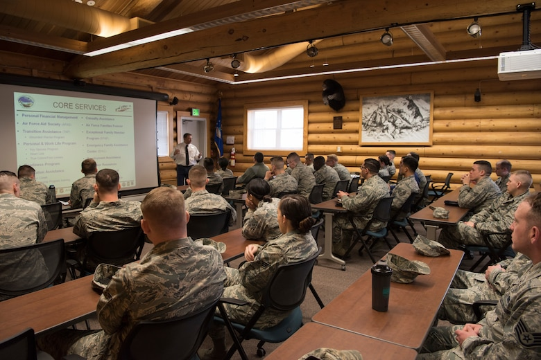 Russell Black Military Family Readiness Center director, speaks to Airman Leadership School graduates about the MFRC at Joint Base Elmendorf-Richardson, Alaska, May 10, 2018. The graduates took part in a new Pacific Air Forces-wide initiative for all ALS graduates to reinforce information obtained in Initial Supervisor Resiliency Training. At the forefront of this initiative is a bus tour the day after graduation, which offers an opportunity to see and interact with the programs and resources discussed during the course.