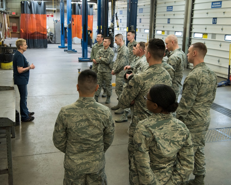 Annette Reed Polar Express Arts and Crafts director, speaks to Airman Leadership School graduates about the Auto Shop at Joint Base Elmendorf-Richardson, Alaska, May 10, 2018. The graduates took part in a new Pacific Air Forces-wide initiative for all ALS graduates to reinforce information obtained in Initial Supervisor Resiliency Training. At the forefront of this initiative is a bus tour the day after graduation, which offers an opportunity to see and interact with the programs and resources discussed during the course.