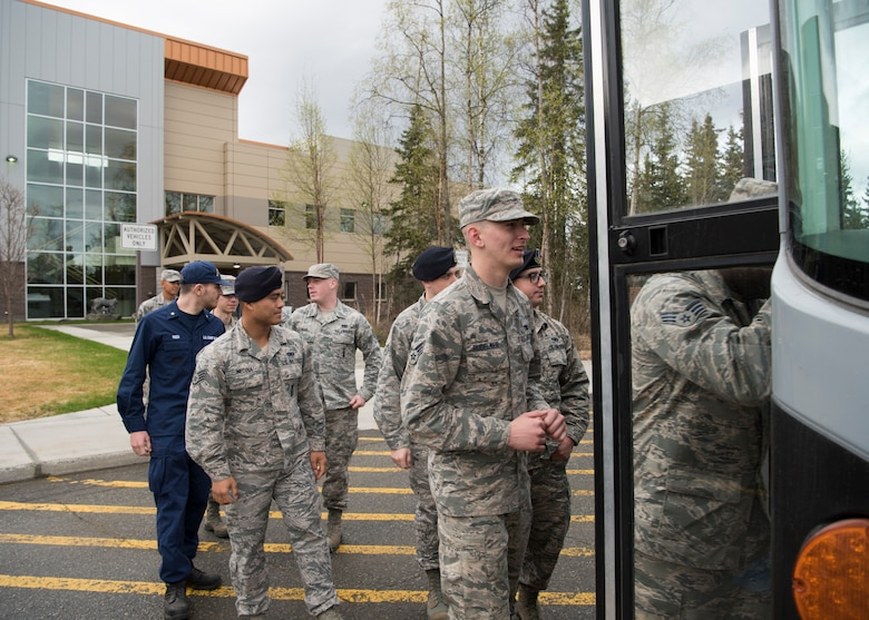 Recent Airman Leadership School graduates walk out of the Mental Health clinic as part of an Initial Supervisor Resiliency Training bus tour at Joint Base Elmendorf-Richardson, Alaska, May 10, 2018. The tour is a new Pacific Air Forces-wide initiative for all ALS graduates, which offers an opportunity to see and interact with the programs and resources discussed during the course.