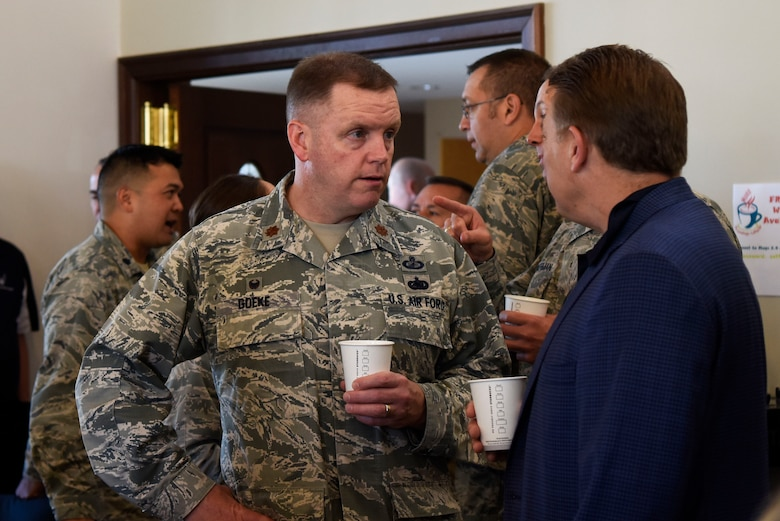 Maj. Robert Goeke, 436th Contracting Squadron commander, and Scott Connell, investment planner at Merrill Lynch, talk an honorary commanders' meet-and-greet May 9, 2018, at Dover Air Force Base, Del. Each honorary commander is paired with a squadron commander in order to learn more about what the Airmen at Dover AFB do. (U.S. Air Force photo by Airman 1st Class Zoe Wockenfuss)