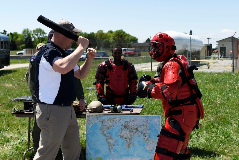 Kevin Mills, comptroller at Dover Motorsports, practices baton strikes on Airman 1st Class Alfonso Bustamante, 436th Security Forces raven, during an honorary commanders' tour May 9, 2018, at Dover Air Force Base, Del. The tour group went from station to station getting a glimpse at different squadrons within the 436th Mission Support Group. (U.S. Air Force photo by Airman 1st Class Zoe Wockenfuss)