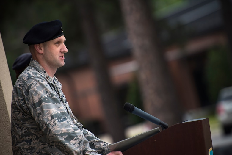 Maj. Charles Tenney, 23d Security Forces Squadron commander, offers opening remarks for Moody's celebration of Police Week, May 14, 2018, at Moody Air Force Base, Ga. Police Week is celebrated in May of each year and is a national effort to recognize and honor law enforcement members who have lost their lives in the line of duty. Moody's 2018 celebration includes a security forces muster, a 5k run, a vehicle showcase with vehicles from the Valdosta Police Department and the Georgia State Patrol as well as memorial ceremonies. (U.S. Air Force photo by Staff Sgt. Ryan Callaghan)