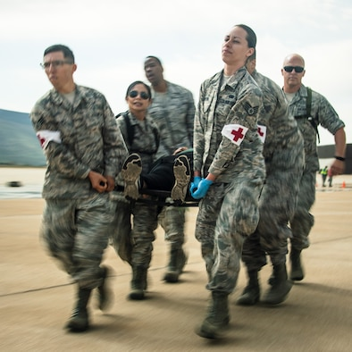 Airmen carry a simulated casualty during an major accident response exercise May 9, 2018, at Hill Air Force Base, Utah. Emergency response personnel from the base and surrounding communities participated in the exercise along with Airmen in prepartion for the Warriors Over the Wasatch Air and Space Show June 23-24. (U.S. Air Force photo by R. Nial Bradshaw)