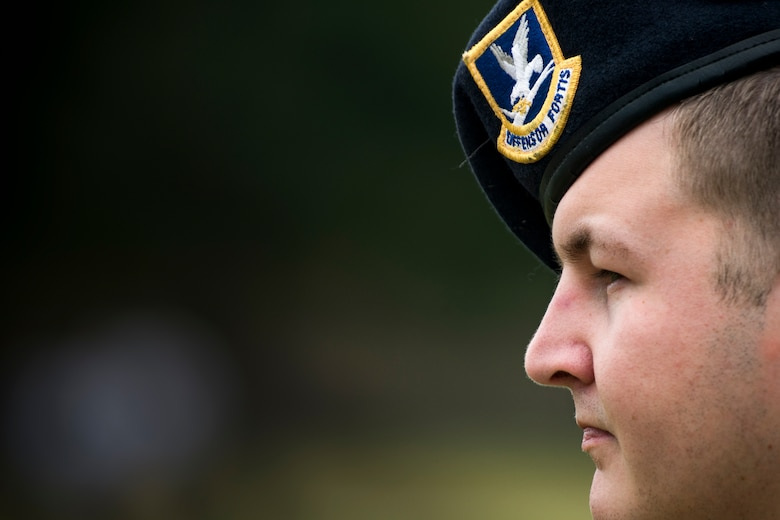 Senior Airman Dustin Hewett, 824th Base Defense Squadron fireteam member, watches as teams compete in relay-style games during Moody's celebration of Police Week, May 14, 2018, at Moody Air Force Base, Ga. Police Week is celebrated in May of each year and is a national effort to recognize and honor law enforcement members who have lost their lives in the line of duty. Moody's 2018 celebration includes a security forces muster, a 5k run, a vehicle showcase with vehicles from the Valdosta Police Department and the Georgia State Patrol as well as memorial ceremonies. (U.S. Air Force photo by Staff Sgt. Ryan Callaghan)