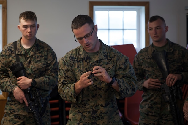 U.S. Marine Sgt. Derek R. Rush, marksmanship coach with Headquarters and Service Company, 6th Engineer Support Battalion, 4th Marine Logistics Group, Marine Forces Reserve, teaches how to properly break down a rifle during exercise Red Dagger at Fort Indiantown Gap, Pa., May 13, 2018.