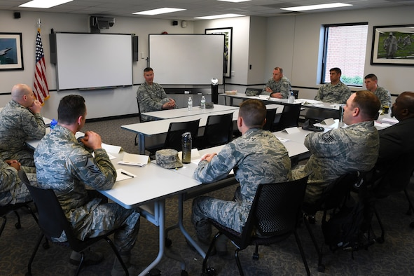 Chief Master Sgt. Brian Thomas, 319th Air Base Wing command chief, center, speaks to enlisted service members, officers and civilian employees in current or future leadership positions during a course focused on leadership May 8, 2018, on Grand Forks Air Force Base, North Dakota. The three-day Flight Leader Course is the first of its kind to be offered at Grand Forks AFB, and is designed to inform and expose class participants to important information which will help them succeed in their roles as leaders. (U.S. Air Force photo by Airman 1st Class Elora J. Martinez)