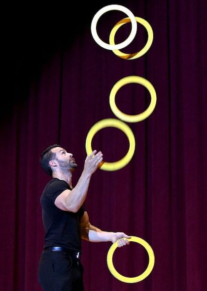 Ivan Pecel, juggler, performs a routine during his show at the Welch Theater at Keesler Air Force Base, Mississippi, May 9, 2018. Pecel, an award winning juggler with more than 15 years of juggling experience, is also a comedian and performed during the first season of America's Got Talent. (U.S. Air Force photo by Kemberly Groue)