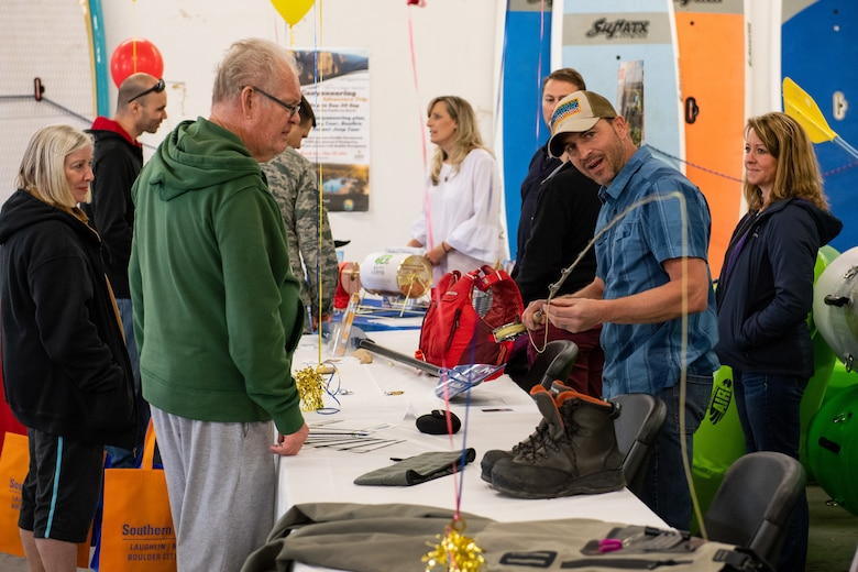 Matt Mravetz, Wasatch Adventure Guide, shows Bruce Petersen a fly rod during the Summer Expo May 11, 2018, at Hill Air Force Base, Utah. The event featured more than 40 informational booths highlighting on- and off-base services, cultural awareness information and resources in the area of travel and recreational opportunities. (U.S. Air Force photo by R. Nial Bradshaw)