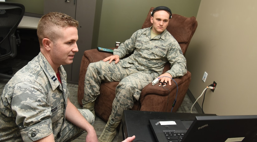 Capt. Daniel Gibson, 92nd Medical Operation Squadron psychologist, goes over the Nexxus Biotrace with Staff Sgt. Donald Durst, 92nd Aerospace Medicine Squadron aerospace medical technician, May 4, 2018 at Fairchild Air Force Base, Wash. The program allows patients to see how their body is responding to both physical and mental stress. The patient is able to visualize what his or her body is doing under stress and see how it differs when in a relaxed state. (U.S. Air Force photo by Staff Sgt. Samantha Krolikowski)