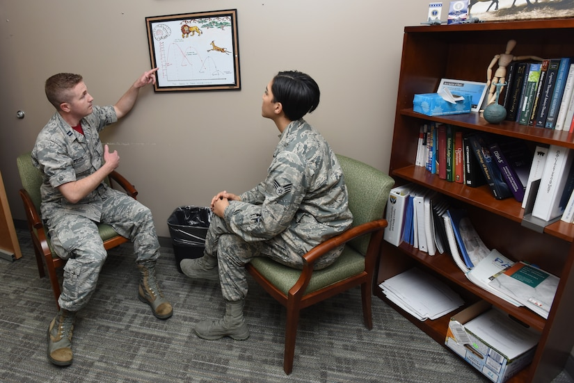 Capt. Daniel Gibson, 92nd Medical Operation Squadron psychologist, conducts one-on-one counseling with Senior Airman Jasmine Dougherty, 92nd Medical Operation Squadron Alcohol Drug Abuse Prevention Treatment technician, May 4, 2018 at Fairchild Air Force Base, Wash. (U.S. Air Force photo by Staff Sgt. Samantha Krolikowski)