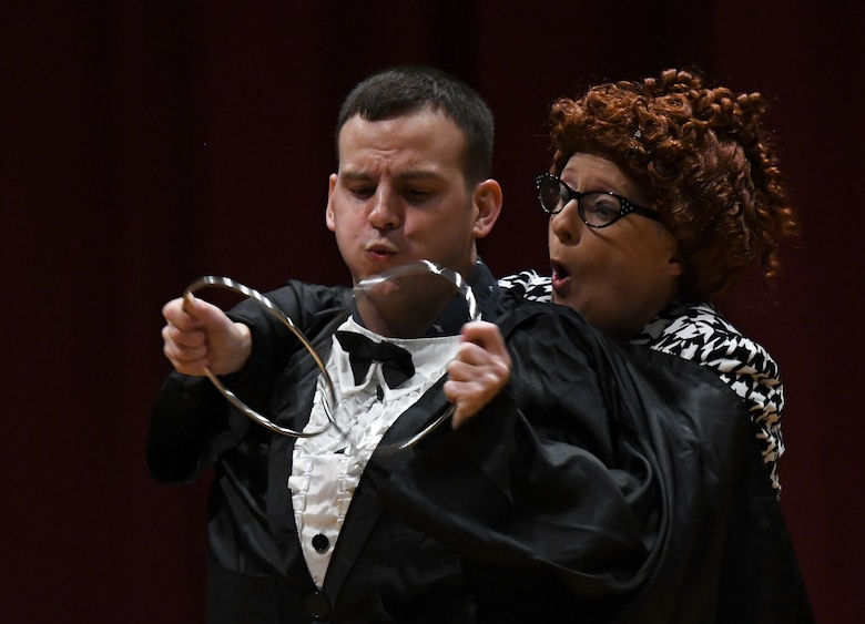 U.S. Air Force 2nd Lt. Jose Rodriguez Hernandez, 335th Training Squadron personnel student, and April Vollm, comedian, perform an act during the Ivan Pecel pre-show at the Welch Theater at Keesler Air Force Base, Mississippi, May 9, 2018. The 81st Force Support Squadron and The Air Force Services Activity hosted the event. (U.S. Air Force photo by Kemberly Groue)