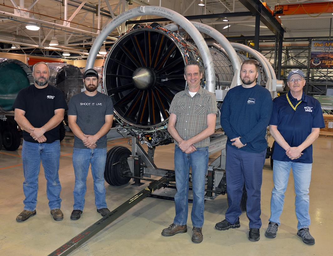 (Left to right) Marcus Moore, Korey Blundy, Warren Flick, Dustin Troutman and Rick Emlet stand in front of a Pratt and Whitney F135 turbofan engine used in all variants of the F-35 Lightning II April 25, 2018, at Hill Air Force Base, Utah. (U.S. Air Force photo by Alex R. Lloyd)