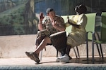 Sgt. James Hance, combat engineer, Bravo Company, 572nd Brigade Engineer Battalion, 86th Infantry Brigade Combat Team (Mountain), plays a drum with a local performer after the conclusion of range renovations, Mount Rolland Training Site; Senegal, April 18, 2018. The Vermont National Guard and Senegalese Armed Forces engineers are renovating the firing range through their State Partnership Program relationship and marks the 10-year anniversary of their teamwork. (U.S. Army National Guard Photograph by Officer Candidate Nathan Rivard)