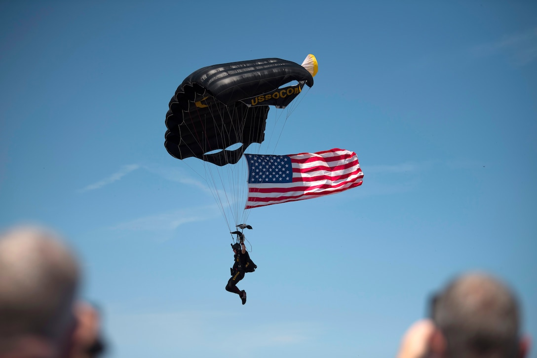 Chris Fucci, of the Para-Commandos, parachutes in on the flightline during Tampa Bay AirFest 2018 at MacDill Air Force Base, Fla., May 11, 2018. The Para-Commandos are U.S. Special Operations Command's premier aerial parachute demonstration team.