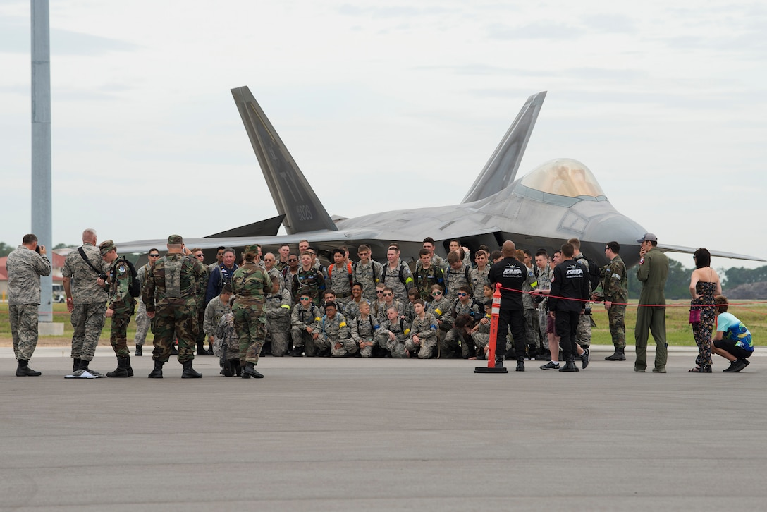 Civil Air Patrol cadets pause for a photo in front of an F-22 Raptor during Tampa Bay AirFest 2018 at MacDill Air Force Base, Fla., May 13, 2018. The F-22 performed as one of 13 aerial demonstrations for the public to enjoy.