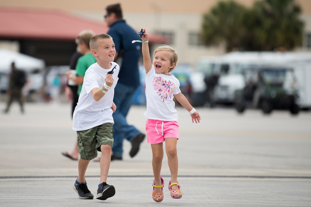 Children play with U.S. Navy Blue Angels toys during the Tampa Bay AirFest 2018 at MacDill Air Force Base, Fla., May 13, 2018. This year's AirFest welcomed approximately 150,000 attendees over a three-day span to experience aerial demonstrations and interactive static displays.