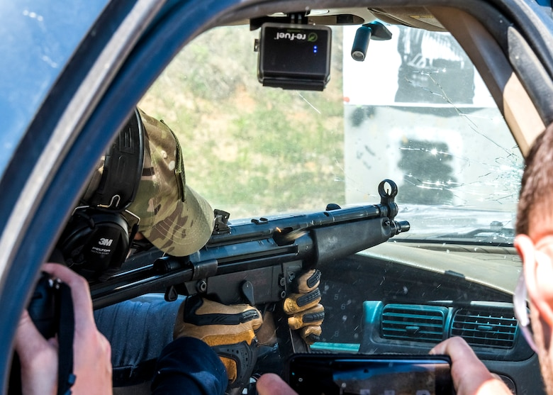 A participant fires an MP-5 from inside a vehicle during the weapons familiarization training of the Senior Leader Security Seminar at Montross, Va., April 30, 2018. The unique two-day anti-terrorism course ensures the safety and survivability of Air Force leaders traveling in medium to critical threat areas. (U.S. Air Force photo by Michael Hastings)