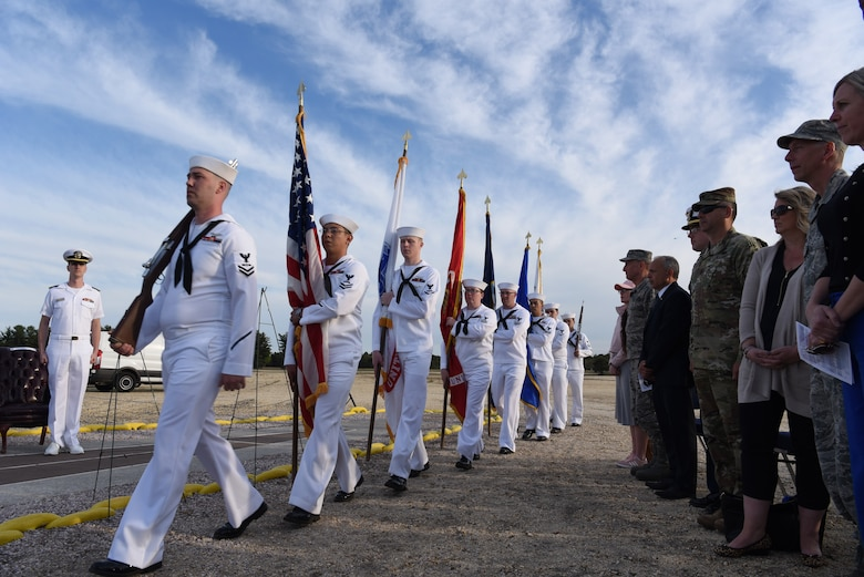 Naval Support Activity Lakehurst Honor Guard marches in to post the colors at Joint Base McGuire-Dix-Lakehurst, N.J. on May 09, 2018. The Honor Guard began the sequence of events for the Hindenburg Memorial Ceremony. (U.S. Marine Corps photo by Lance Cpl. Stanley Moy/ Released)