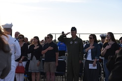 Attendees of the Hindenburg Memorial Ceremony salute or place their hands over their heart during the playing of colors at Joint Base McGuire-Dix-Lakehurst on May 09, 2018. This was the 81st anniversary of the Hindenburg Airship disaster. (U.S. Marine Corps photo by Lance Cpl. Stanley Moy/ Released)
