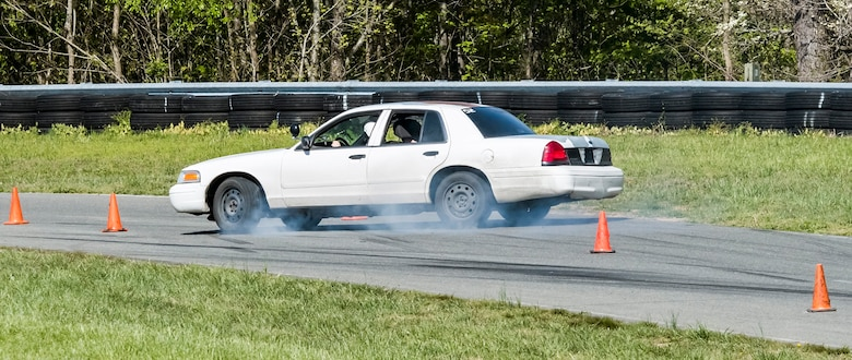 Participants demonstrate high-speed skid control technique during the instinctive driving training of the Senior Leader Security Seminar at Montross, Va., May 1, 2018. The unique two-day anti-terrorism course ensures the safety and survivability of  Air Force leaders traveling in medium to critical threat areas. (U.S. Air Force photo by Michael Hastings)