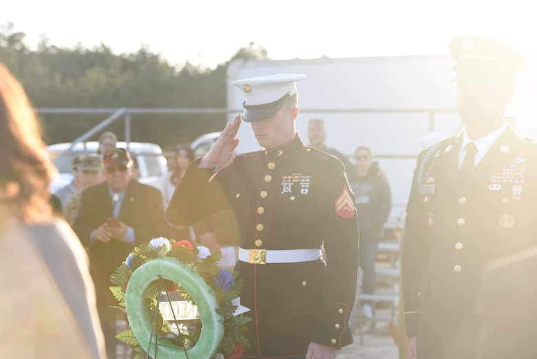Cpl. Eric Flemming salutes a wreath during the Hindenburg Memorial Ceremony at Joint Base McGuire-Dix-Lakehurst on May 09, 2018. The wreath presentation was done to honor all Navy and Army airship losses. (U.S. Marine Corps photo by Lance Cpl. Stanley Moy/ Released)