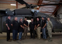 """Members of the 58th Training Squadron, Trainer Development Team """"Monster Garage,"""" pose for a photo at Kirtland Air Force Base, N.M., May 11. The Monster Garage won the Air Education and Training Command 2018 General Larry O. Spencer Innovation Award in the team category. (U.S. Air Force photo by Staff Sgt. J.D. Strong II)"""
