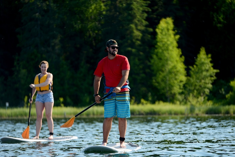 Trevor Bird, paddle board instructor at Otter Lake Lodge, and Senior Airman Sheriah Colcleaser, with the 673d Medical Group, paddle toward the center of Otter Lake at Joint Base Elmendorf-Richardson, Alaska, June 22, 2015. JBER is scheduled to host an Airmen Appreciation Day at Otter Lake at 2 p.m., June 1, 2018. The event invites senior airmen and below, plus one guest each, to participate in an afternoon of free food and activities. Free activities include paintball, kayaking, paddle boats, stand-up paddle boards, inflatable jousting, bubble ball suit soccer, inflatable darts, volleyball, horseshoes, video games and card games.
