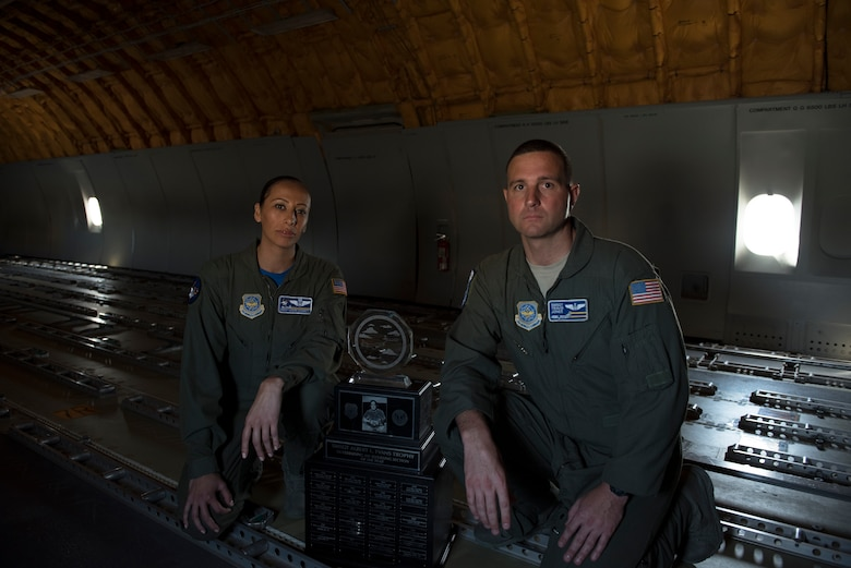 Senior Master Sgt. Lucero Stockett (Left), 6th Air Refueling Squadron Boom Operator superintendent, poses for a photo with Master Sgt. James Cain, 6th ARS Operations superintendent (Right), and the Senior Master Sgt. Albert L. Evans Trophy inside a KC-10 Extender at Travis Air Force Base, Calif., May 11, 2018. The 6th ARS In-Flight Refueling Section was presented the award during the 39th Annual Boom Operator's Symposium, which was held at Altus AFB, Okla., from April 27 – 29. The award is given annually to the most outstanding air refueling section in the Air Force. The 6th ARS has been awarded the honor six times, more than any other Air Force unit. (U.S. Air Force photo by Tech. Sgt. James Hodgman)