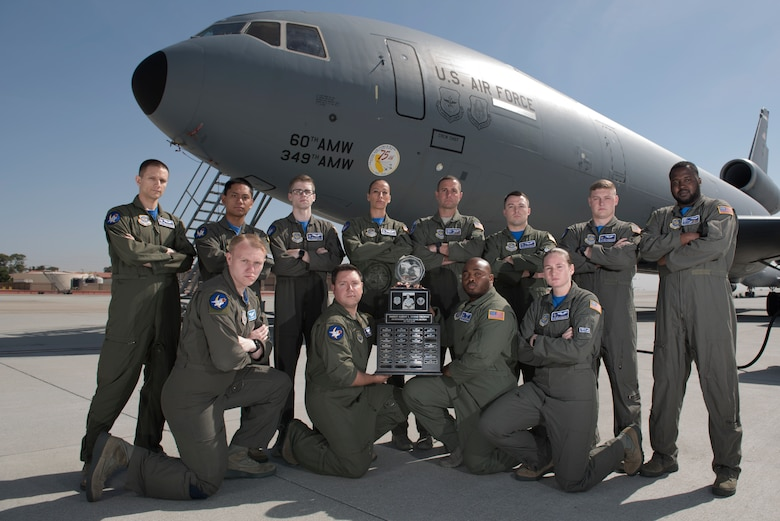 Twelve members of the 6th Air Refueling Squadron pose for a photo with the Senior Master Sgt. Albert Evans Trophy at Travis Air Force Base, Calif., May 11, 2018. The 6th ARS In-Flight Refueling Section was presented the award during the 39th Annual Boom Operator's Symposium, which was held at Altus AFB, Okla., from April 27 – 29. The award is given annually to the most outstanding air refueling section in the Air Force. The 6th ARS has been awarded the honor six times, more than any other Air Force unit. (U.S. Air Force photo by Tech. Sgt. James Hodgman)