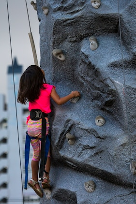 A child climbs to the top of the rock wall in Fun Land during Foster Fest May 12 aboard Camp Foster, Okinawa, Japan. The annual festival allowed members of the community to enjoy food, games and music. More than 13,000 people attended the two-day event. (U.S. Marine Corps photo by Pfc. Nicole Rogge)
