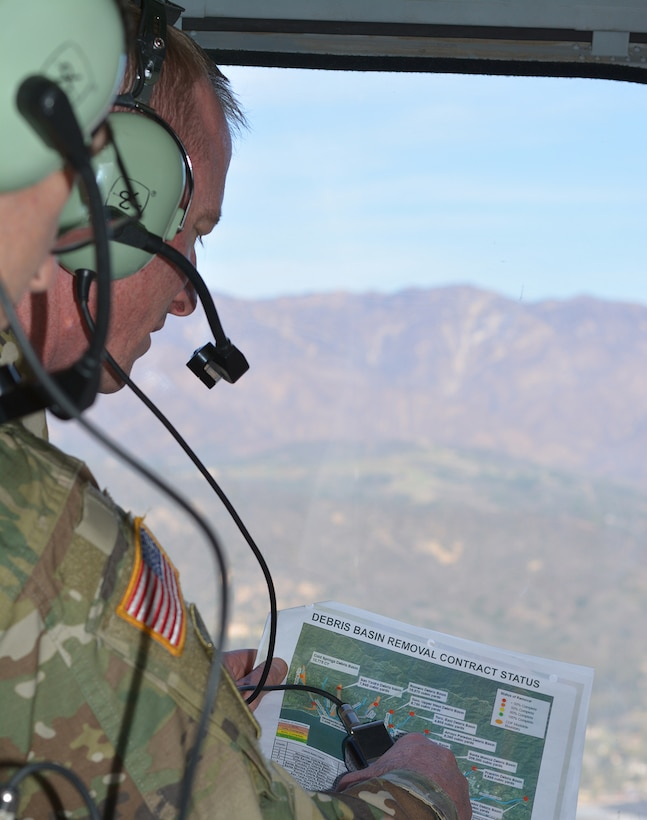 Col. Kirk Gibbs, U.S. Army Corps of Engineers Los Angeles District commander, views a map of the basins where the Corps is working on removing debris while flying over the area in a UH-60 Blackhawk helicopter over Santa Barbara County.